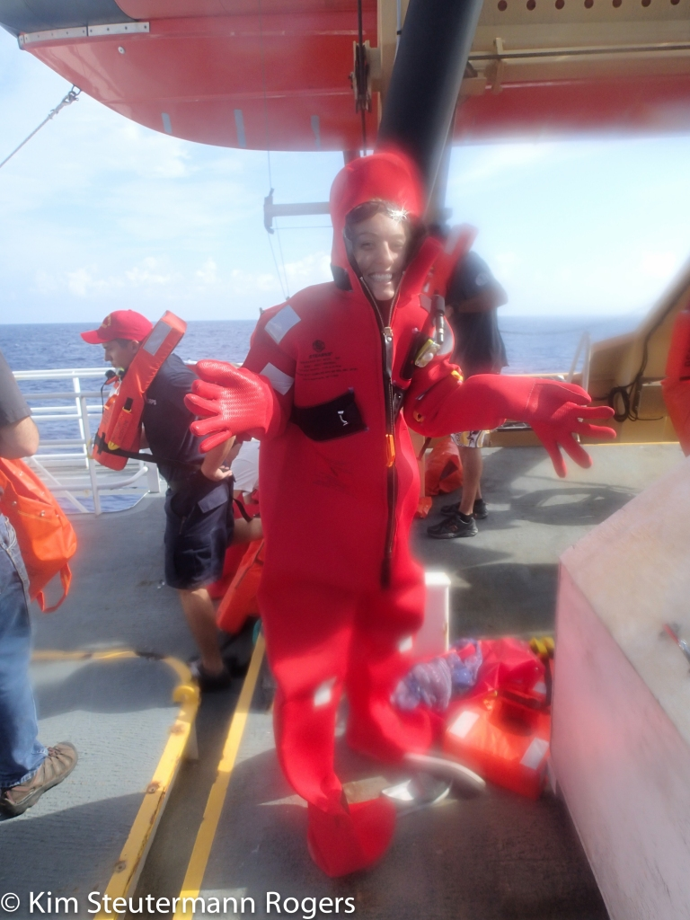 Sarah wearing a survival suit at sea